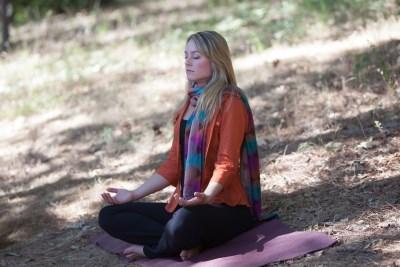 lis-meditating-outdoors